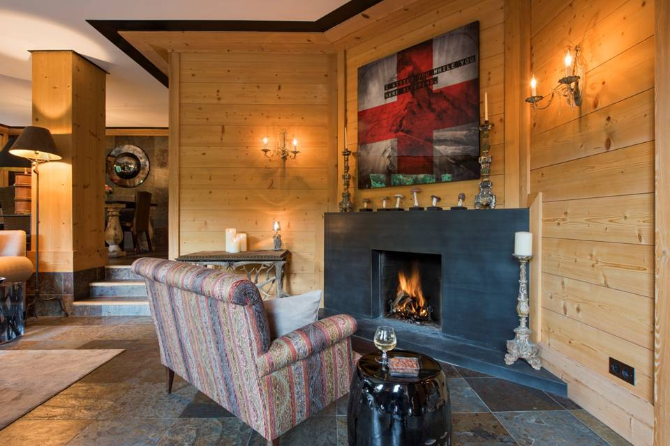 Chalet Aflabim, Gstaad, main living room and open fireplace