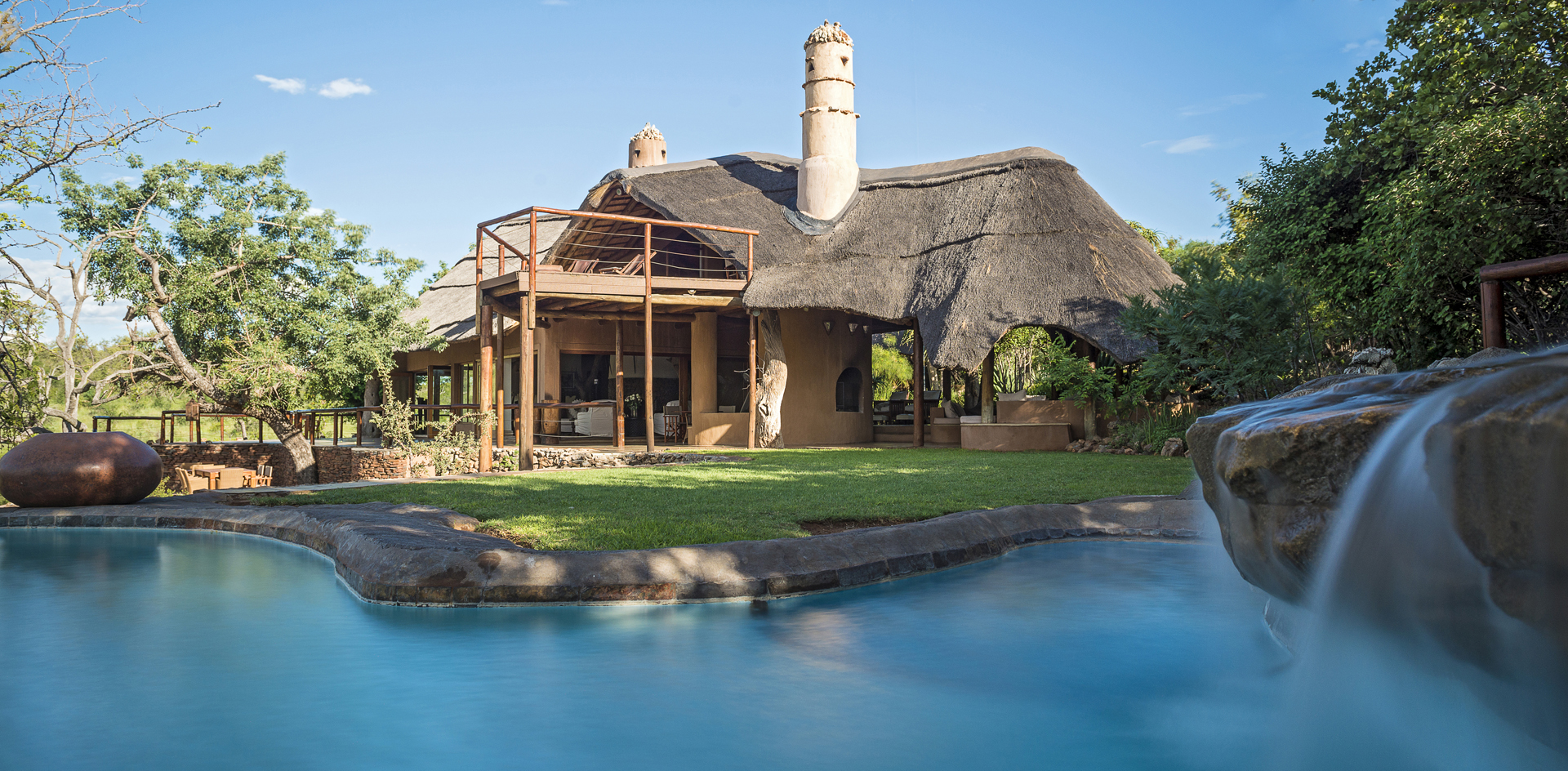 Private pool with waterfall of Royal Madikwe's Luxury Suite
